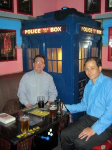 Myself and Ed Fortune sat in front of a TARDIS. Picture taken by Frances Hardinge