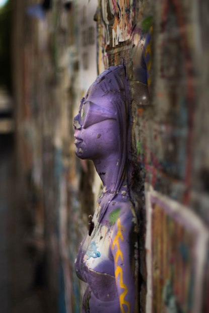 Purple relief figure in Brick lane, London
