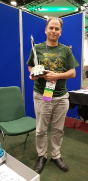 Me holding a Hugo award